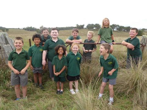 image of students posing in long grass